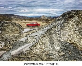 GOBUSTAN, AZERBAIJAN - November 2016: Old red car at mud volcanoes area in Gobustan, Azerbaijan
