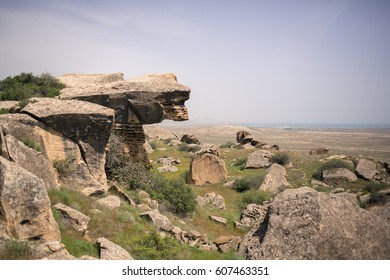Gobustan Rock Art Cultural Landscape in Azerbaijan. Image with selective focus and toning.