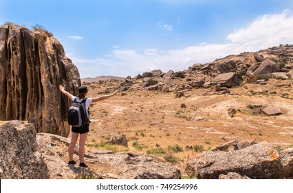 Gobustan Rock Art Cultural Landscape - woman standing alone in the rock - Gobustan Azerbaijan September 2017