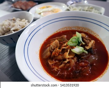 Gochujang Jjigae. Jjigae is a Korean dish similar to a Western stew. It is typically made with meat, seafood or vegetables in a broth seasoned with gochujang, doenjang, ganjang or saeujeot.