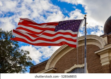 God Bless America American flag and old church steeple reflect separation of state