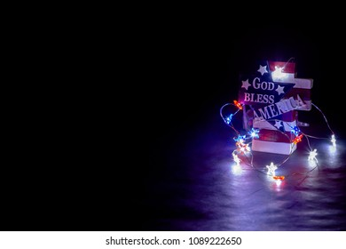 God Bless America cross with lights on dark background