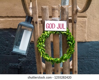 God Jul - Merry Christmas sign with green wreath at Stockholm street