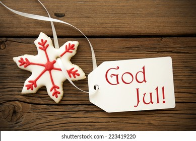 God Jul, which is swedish and means Merry Christmas, on a Label with a red white Christmas Star Cookie