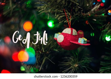 God Jul, which is swedish or norwegian and means Merry Christmas. Happy New Year card. Christmas background with Christmas tree.