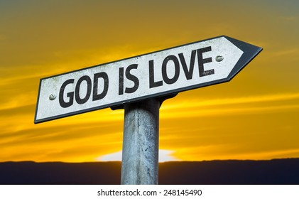 God is Love sign with a sunset background