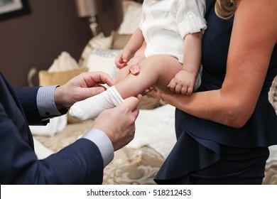 God Parents dressing God Child Baby for Christening Baptism