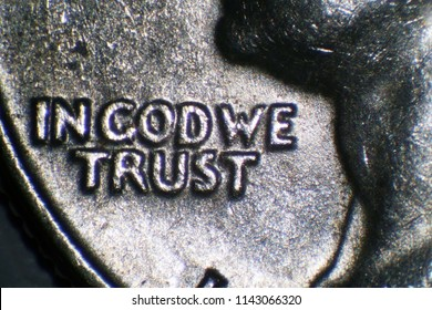 IN GOD WE TRUST. Microscopic View of the worlds in god we trust on a us quarter dollar.