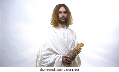 God in white robe holding wine bottle, Eucharist in Catholic church, Communion
