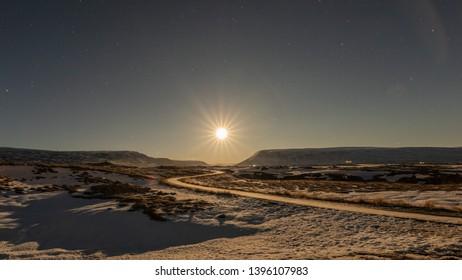 Godafoss, Akureyri, Iceland Dec 21 2018: moon setting near godafoss waterfalls