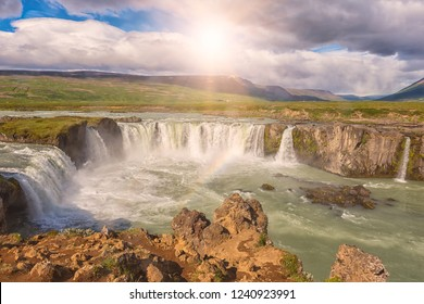 Godafoss (Akureyri) waterfall at sunny day, spectacular landscape of Iceland iconic place with blue cloudy sky. Skjalfandafljot river, Norðurland, North of Iceland