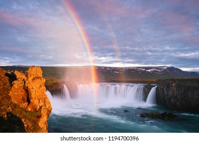 Godafoss - one of the Iceland waterfalls. Natural and tourist attraction. Summer landscape with a rainbow