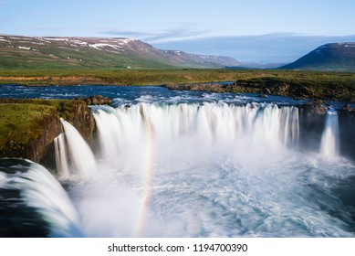 Godafoss - one of the Iceland waterfalls. Summer landscape on a sunny day. Tourist attraction with rainbow