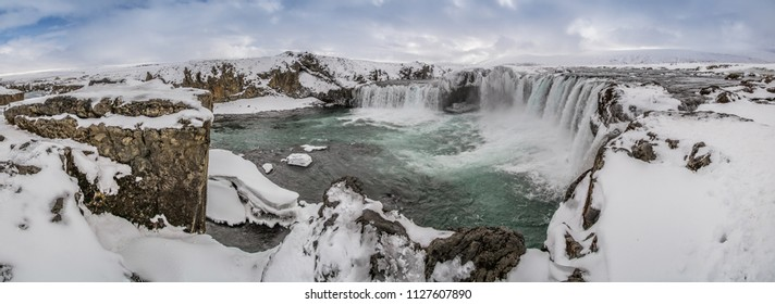 "Godafoss, One of the most famous waterfalls in Iceland. Godafoss covered in snow and ice. Godafoss, or the ""Waterfall of the Gods,"" one of Iceland's most beautiful waterfalls in winter."