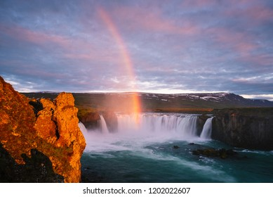 Godafoss waterfal, Iceland. Famous Tourist Attraction. Summer landscape with a rainbow