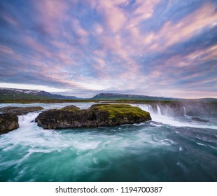 Godafoss waterfal, Iceland. Landscape with a cascade on the river and a beautiful sky at sunset