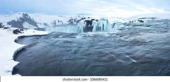 """Godafoss, or the """"Waterfall of the Gods,"""" one of Iceland's most beautiful waterfalls, shown here in winter.  While spectacular from below, this is a less-photographed view, from above."""