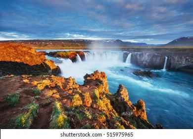 Godafoss waterfall at sunset. Fantastic landscape. Beautiful cumulus clouds. Iceland, Europe
