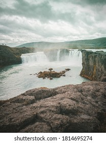Godafoss waterfall in this moody portrait in Icelandic nature is a landmark of iceland. Famous Icelandic nature shows powerful streaming rives and scenic view of natural place of the vikings.