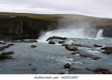Godafoss waterfalls Iceland with mountain range in background
