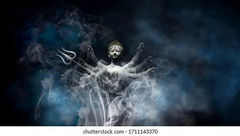 Goddess Durga in smoke or Happy Durga Puja Subh Navratri background