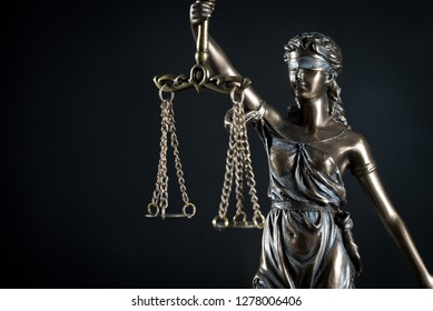 Goddess of justice on a beautiful black background. the subject of law