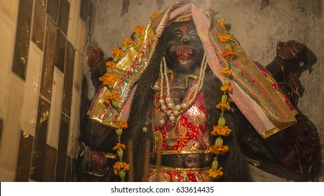 Goddess Kali Ma and God Bhairav Murti in Jaipur local Temple. Statues of Hindu Gods and Goddess in Rajasthan. Black Kali sculpture in small hindu Mandir.