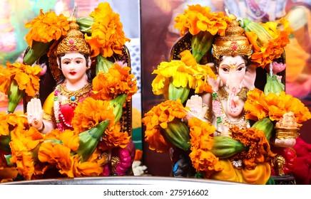 goddess lakshmi and lord ganesha statue, pray concept