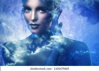 Goddess of the universe. Beautiful model in creative image of fantasy character.