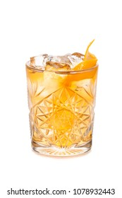 Godfather rusty nail cocktail decorated with orange slice