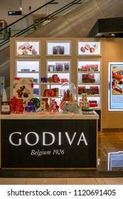 Godiva shop at Mega Bangna, Bangkok, Thailand, Jun 2, 2018 : Belgium chocolate shop display and  modern interior. Premium retail store by escalator in the shopping center.