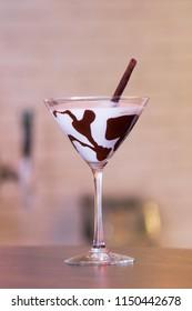 Godiva White Chocolate Martini Glass with a black Chocolate stick