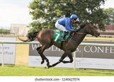 The Godolphin owned and bred horse Perisher ridden by David Allan wins the Novice Stakes at Thirsk Races : Thirsk Racecourse, Thirsk, Nth Yorkshire, UK : 17 July 2018 : Pic Mick Atkins