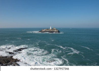 Godrevy Lighthouse in the Bay of St Ives and the Atlantic Ocean by the South West Coast Path between Portreath and Hayle in Rural Cornwall, England, UK