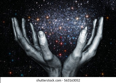 God's hands holding a star galaxy in space