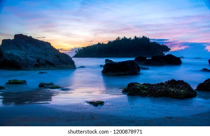 God's own country Kerala Darmadam Beach Kannur, Beautiful Sunset View, Colorful Beach Sky with rocks, Place to visit in India amazing island with coconut trees beach images