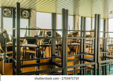 Goesan, South Korea; May 29, 2020: Chairs and tables stacked haphazardly in sunlit room of bankrupt resort.
