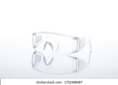 goggle eye wear protective glasses atomization covid 19 contagious disease on white background