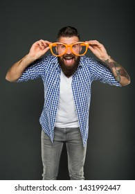 Goggles do more than improve your vision. Bearded man wearing fancy goggles on grey background. Brutal hipster looking through fashion goggles accessory. Trendy goggles perfect for party lifestyle.