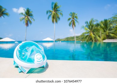 Goggles or mask for snorkeling or swimming near the pool at sunny day. selective focus shot.