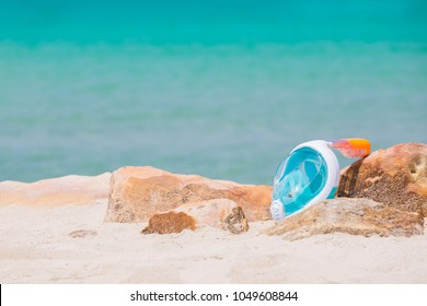Goggles or mask for snorkeling or swimming on the beach at sunny day. selective focus shot.