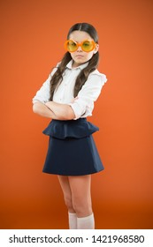 Goggles are more than just eyeglasses. Adorable little girl wearing fancy goggles on orange background. Cute small child with fashion goggles accessory. Choosing perfect party goggles.