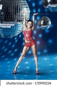 Go-Go dancer girl with disco balls over blue background