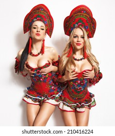 Go-go dancers.Two attractive sexy girls in fetish outfits.Studio shot