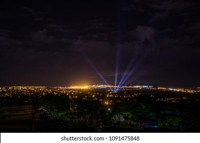 GOIANIA, BRAZIL - ABRIL 21, 2018: Light canons light up the city sky. On April 21, 2018, Goiania, Brazil.