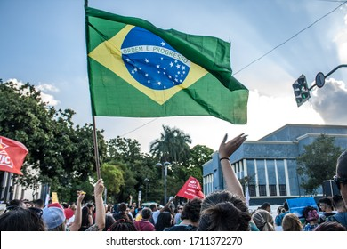 GOIANIA/GOIAS/BRASIL – MAY 15 2019: Brazil's flag. Crowds protest against cuts in education in Brazil. Students and professors from hundreds of universities and colleges on the streets of Brazil.