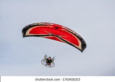GOIANIA/GOIAS/BRAZIL - NOVEMBER 05 2018: Flying on paramotor. Pilot flying from paramotor in cloudy sky.