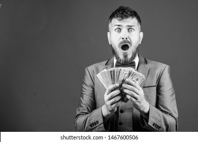 Going crazy. Making money with his own business. Currency broker with bundle of money. Bearded man holding cash money. Rich businessman with us dollars banknotes. Business startup loan, copy space.