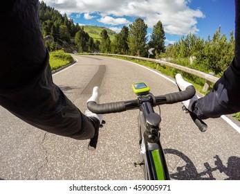 Going Down with road  bike on Pass Pordoi.  Pov original point of view