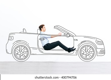 Going far away! Handsome young man driving drawn car against white background